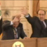 Muntadhar al-Zaidi throws his shoes at then-U.S. President George W. Bush during a press conference in Baghdad, Iraq.